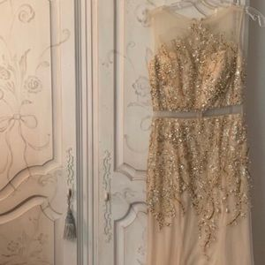 Gold beaded gown with mesh illusions